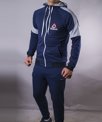 d419643b067565 КупитиСпортивний костюм чоловічий Reebok темно-синій на блискавці з  капюшоном фото, в інтернет-